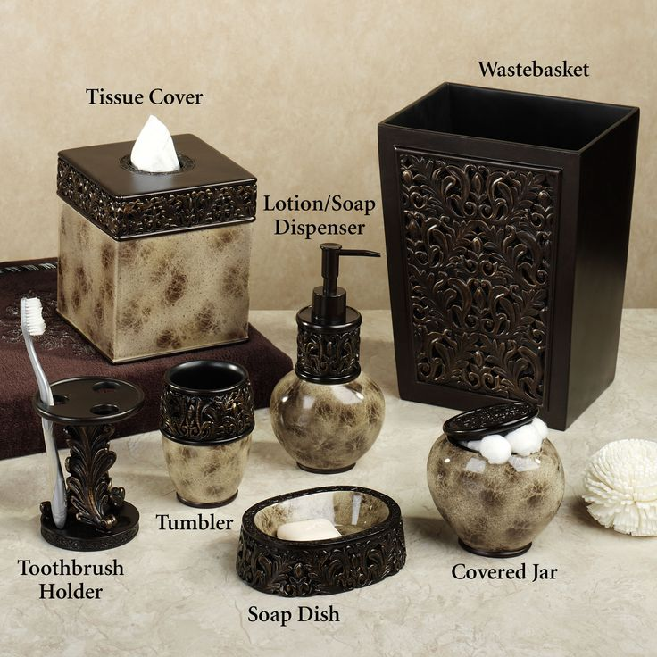 elegant motifs including acanthus leaves and medallion designs grace the mocha argosy bath accessories by croscill