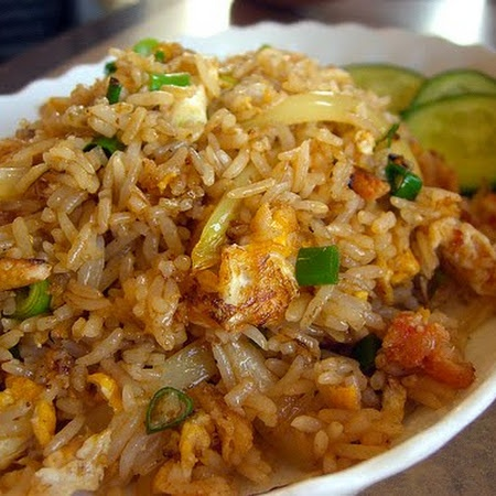 Crab Fried Rice  ⅔	cup long-grain rice 2	Tbsp peanut oil 4½	oz canned white crabmeat, drained 1	leek, sliced 1	cup bean sprouts 2	eggs, beaten 1	Tbsp soy sauce 2	tsp lime juice 1	tsp sesame oil