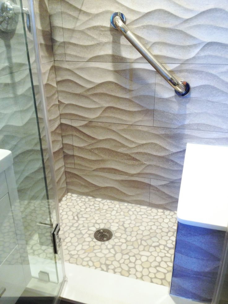 Large White Pebble Tile Shower Floor With Textured Walls