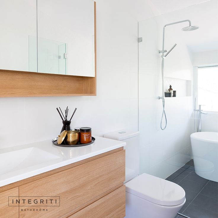 Here's a look at a recent renovation of ours at Gordon. We opted for a clean and simple modern bathroom design. Handle less flat fronted cabinets, a vanity shelf, contrasting floor tiles, with clean lines and edges. . #integritibathrooms #custommade #sydneybathroom #interiordesign #bathroom