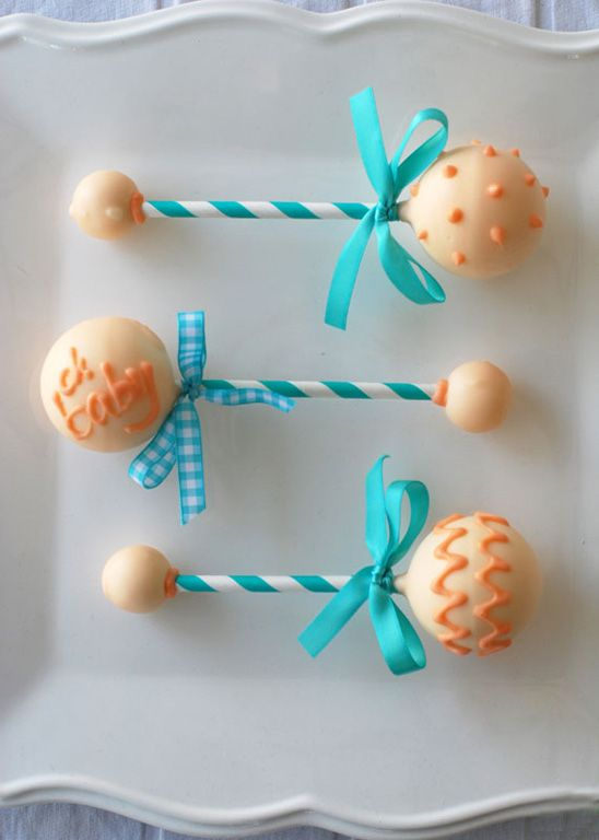 Cake Pop Rattles from a Chic Baby Shower in Aqua and Coral from #whhostess, featured in the new party planning book #stylishkidsparties.