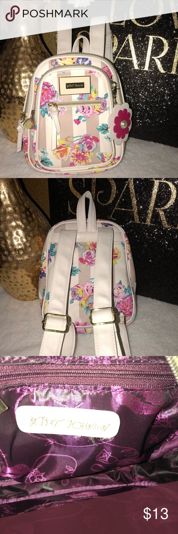 *Betsey Johnson mini backpack •White/cream backpack  •Multi color floral print  •Gently used- good condition Betsey Johnson Bags Backpacks