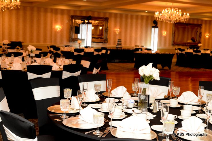 The Sterling Ballroom looks stunning! Bride and groom chose black spandex chair covers and table cloths with white chair bands. Color chair bands are available to match perfectly with your decor! www.SterlingBallroomEvents.com. Photo courtesy of KSS Photography. #NJWeddings #SterlingBallroom #DoubleTree #Bride #Groom #Weddings #CentralNJWeddingVenue #NJWeddingVenue #WeddingPhotography #NJBanquetHall #NJWeddingVenue