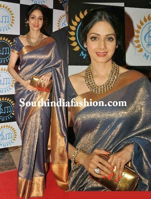 Evergreen actress Sreedevi looks ravishing in grey color bridal silk saree with gold zari work all over the saree and gold kadi border, paired up with grey color short sleeves blouse. Related PostsSridevi in a Manish Malhotra gownTrisha in Blue Kancheepuram SareePraneetha in Bridal SareePrakhya in Orange Bridal Saree
