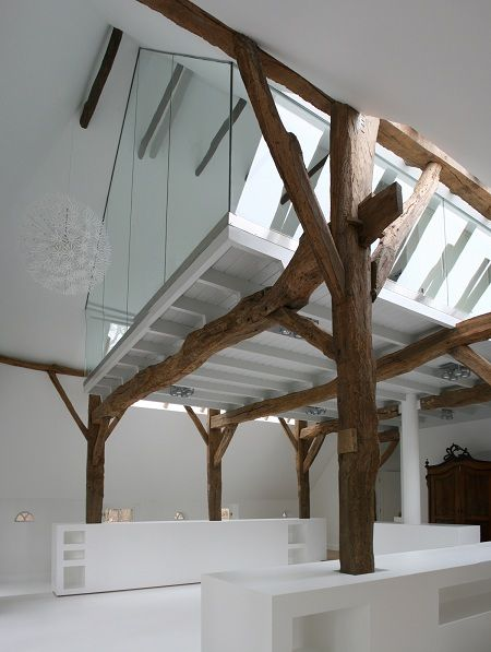 impressive use of space and materials! glass room within an open plan barn like space | white and old timbers