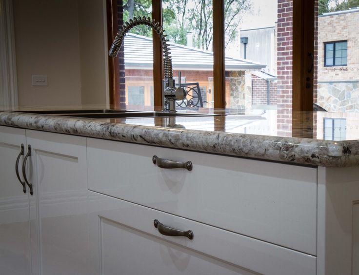 Granite benchtop. Traditional style kitchen. Sink in island. www.thekitchendesigncentre.com.au