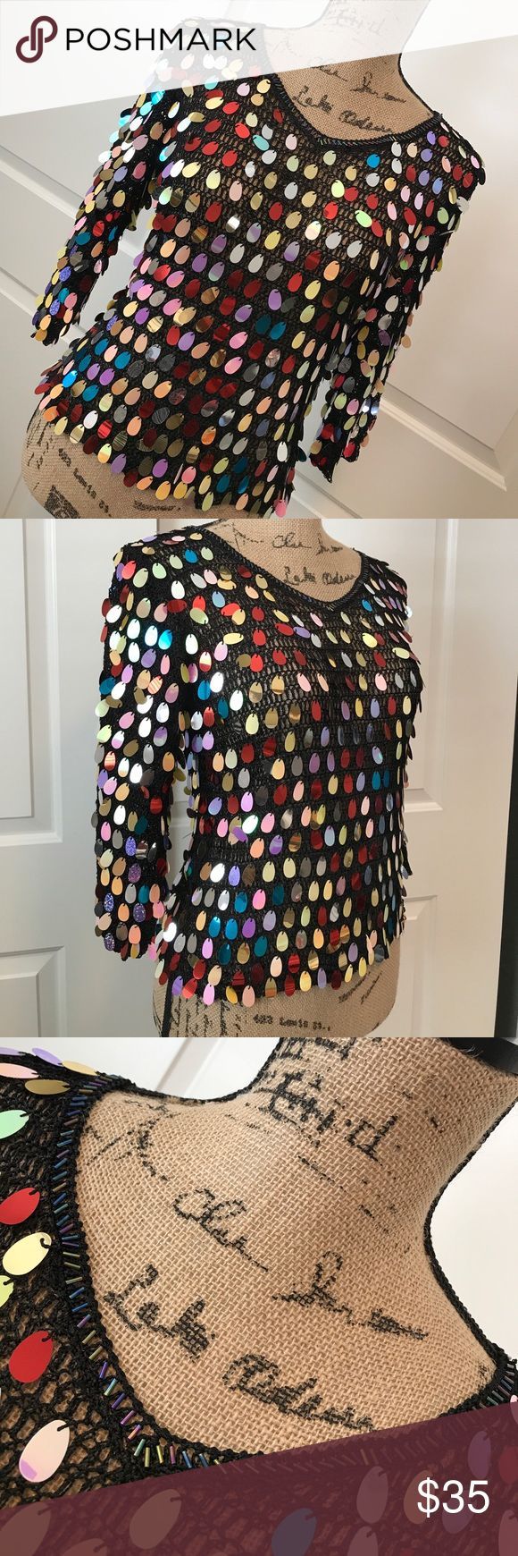 PRETTY ANGEL Mesh Sequined Festival Top Fun, funky and flirty !! This is a black stretch mesh knit top with oval shaped multi colored sequins. Beautiful beading surrounding the neckline. Perfect festival top. This top is BRAND NEW NEVER WORN W/TAGS. Pretty Angel Tops