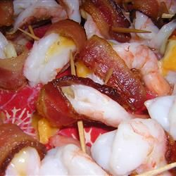 Shrimp kisses....butterfly shrimp, add a small piece of cheese into the opening, and wrap half a slice of bacon around the shrimp to conceal the cheese. Secure with toothpick. Bake 10-15 mins until bacon is browned.