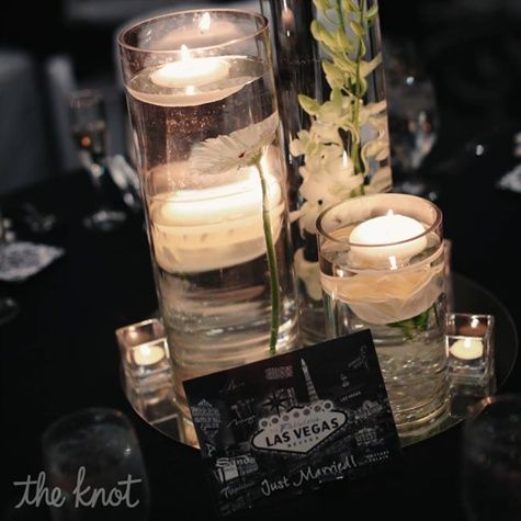 Each table had four cylinders of different heights with orchids, daisies and roses floating in water with floating candles