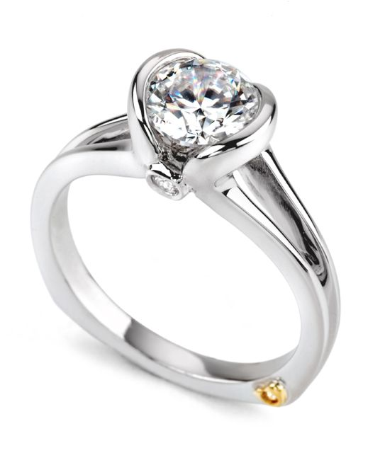 The Debut engagement ring contains 3 diamonds, totaling 0.05 ctw. Center stone sold separately, not included in price.The Debut wedding band contains no diamonds.