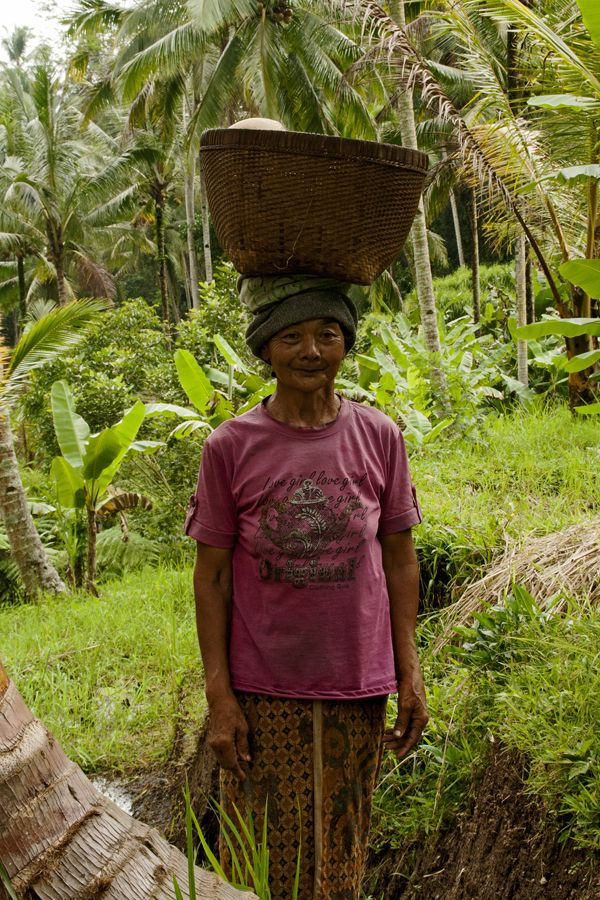 Lady at Ubud's rice terraces, Bali, Indonesia. Photo by Lucy Munday. See more at www.lucymunday.com