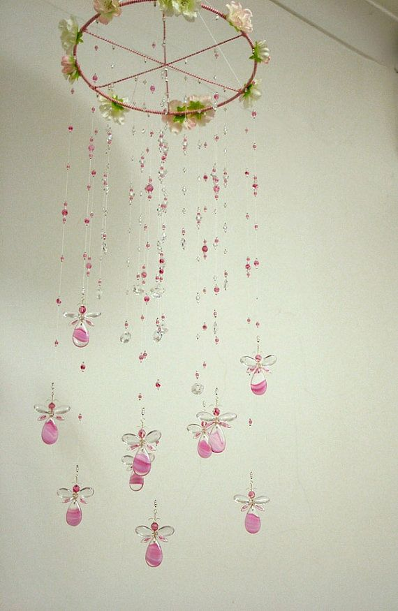 This majestic Pink Fairy / Angel chandelier hanging mobile has been hand crafted from clear Swarovski Crystal & quality Czech glass beads. It has a