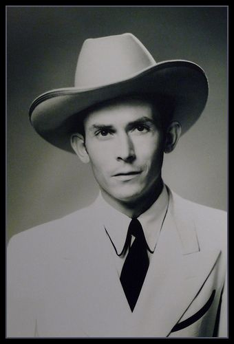 Hank Williams, Move over little dog cause the big dog's movin in.  Hey Good lookin; , what cha got cookin?