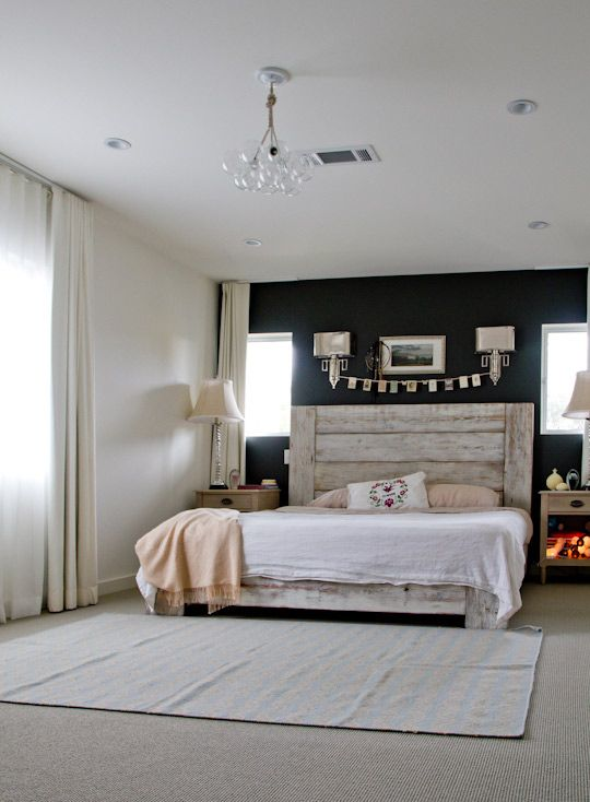 Love this bedroom. Fun light fixture. Paint looks black but I like the idea of a navy blue better. Rustic headboard. Simple bedding. |Pinned from PinTo for iPad|