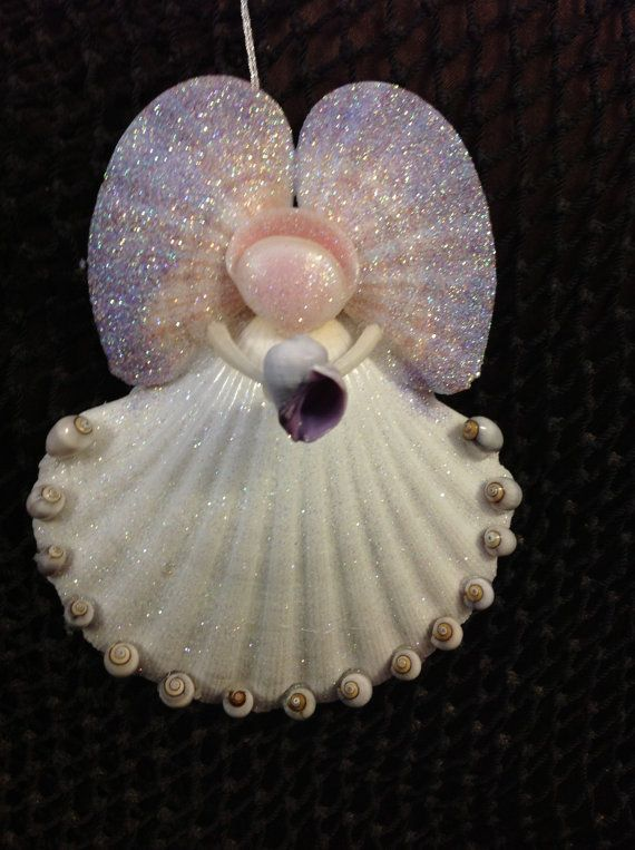 Angel holding a purple shell Ornament with purple shells on her skirt