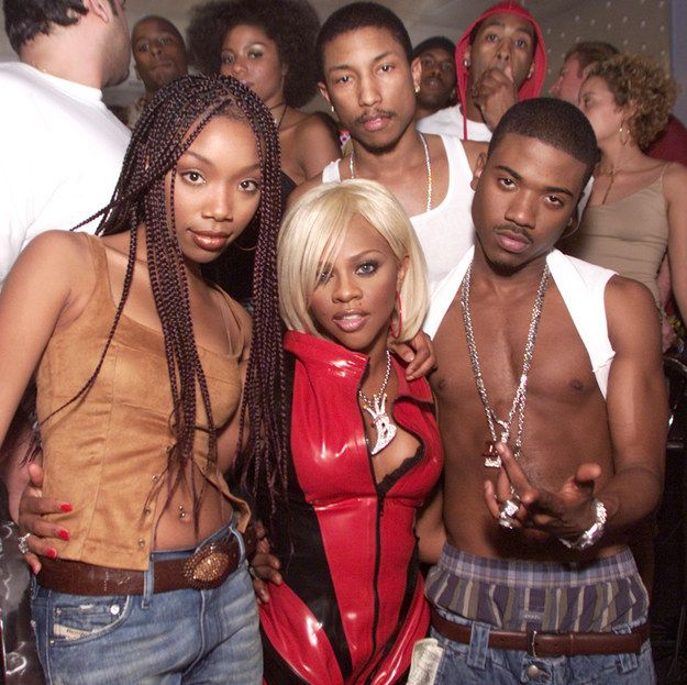 """Brandy, Lil Kim, Ray J, and a mustachioed Pharrell on the set of """"Wait A Minute."""""""