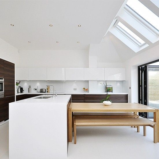 What looks like integrated seating is in fact a cleverly-chosen kitchen table and bench. The proportions are right, the placement is spot on and it would be a fraction of the cost of bespoke integrated kitchen seating.