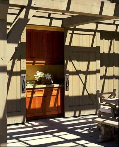 a hidden outdoor kitchen