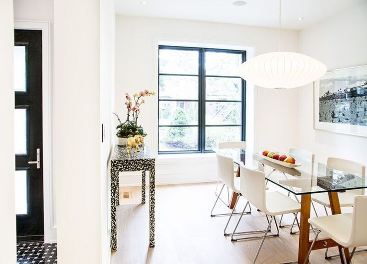 A sublime dining area! Love the oversized light pendant and the glass table top. Adds to the light airiness of the space. And I spy a Snob console and gold-leafed elephant too!