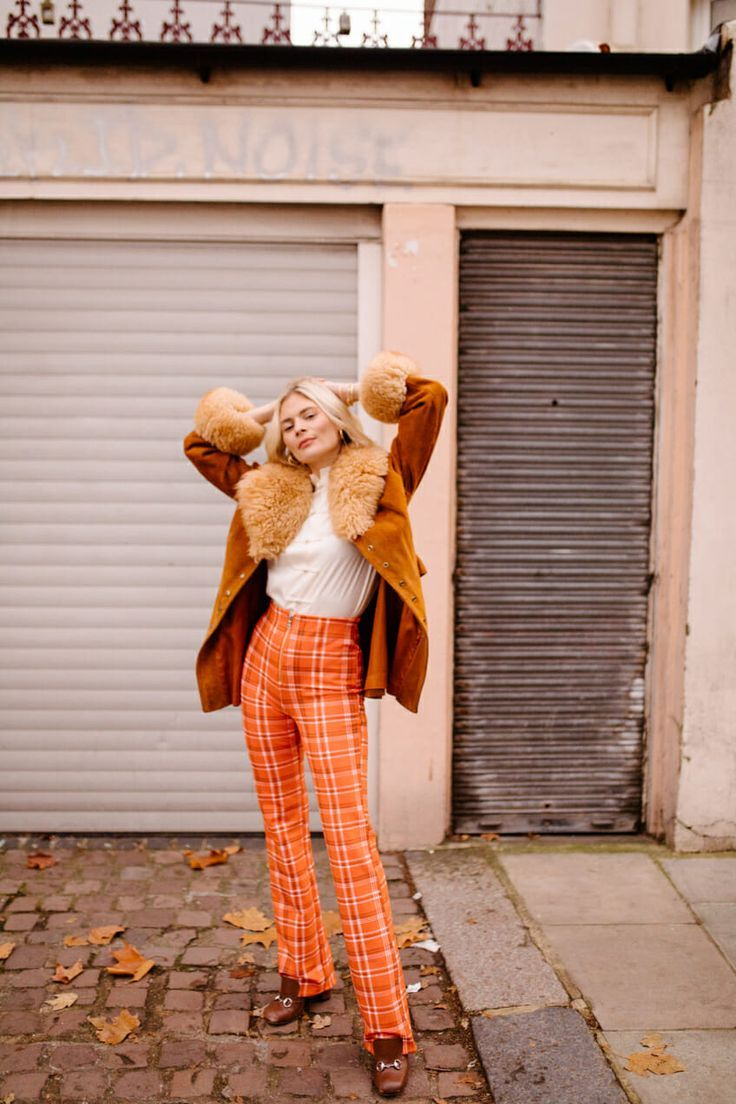 1a746a9611 High rise orange plaid pants with a white blouse and brown faux fur coat.  Visit Daily Dress me at dailydressme.com for more inspiration women s  fashion 2018 ...