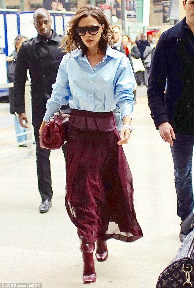 Looking good: The celebrated fashion designer colour blocked with typical élan in a crisp blue dress shirt and sweeping maroon skirt as she sashayed across the picturesque city's Gare Du Nord station