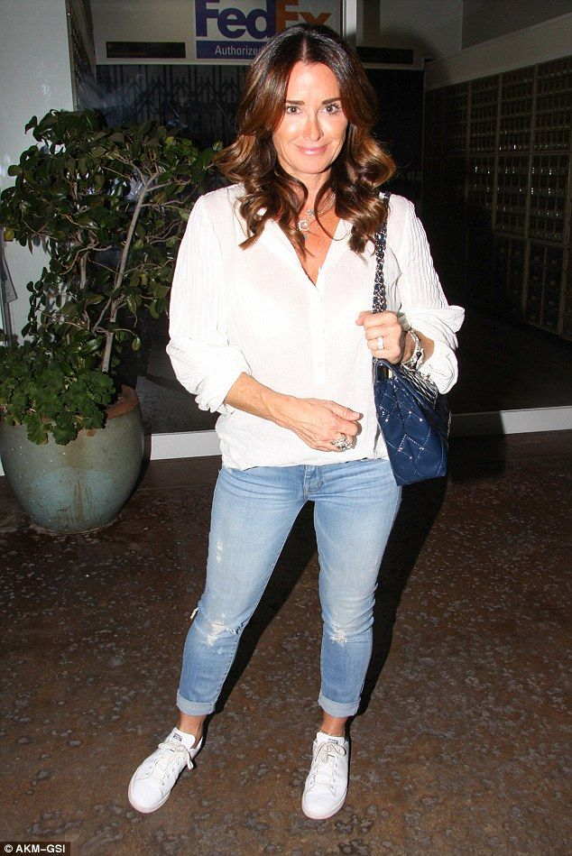 Casual chic: Kyle Richards showed off her timeless look in a white chiffon blouse and cropped denim jeans as she stepped out for an Italian meal on Saturday in Los Angeles