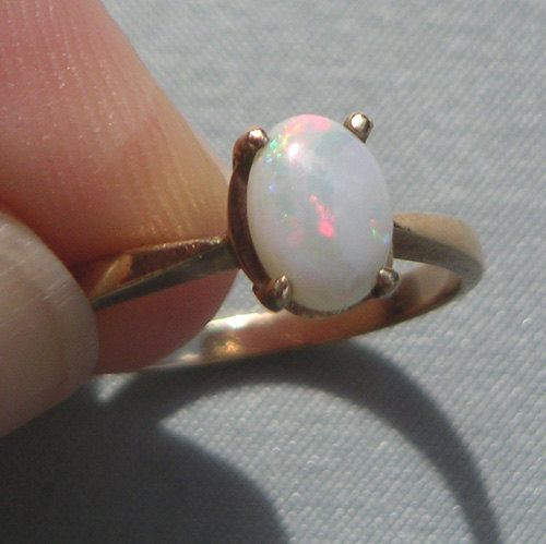 Opal ring- love how simple it is. Really am starting to like the thinner band. Elegant, could wear it everyday!! I want one sooooo bad!!!