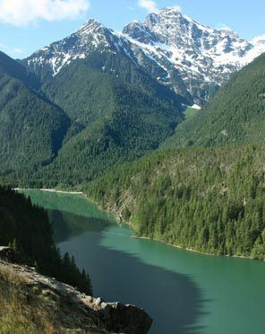 The turquoise waters of Diablo Lake shimmer below the regal visage of Colonial Peak. It's one of the many scenic sites along the North Cascades Highway.