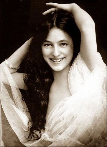 """""""EVELYN NESBIT --Known to millions before her 16th birthday in 1900, Evelyn was the most photographed woman of her era, an iconic figure who set the standard for female beauty. Her jealous millionaire husband, Harry K. Thaw, killed her lover, Stanford White, the architect of much of New York. She found herself at the center of the Crime of the Century and the star of a great courtroom drama."""""""