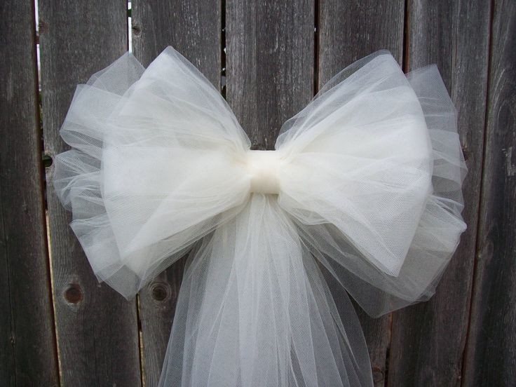 Tulle Pew Bow, Tulle Wedding, Formal Aisle Decor, Quinceanera Decorations, Ivory Pew Bow, White Tulle Pew Bow. $13.00, via Etsy.