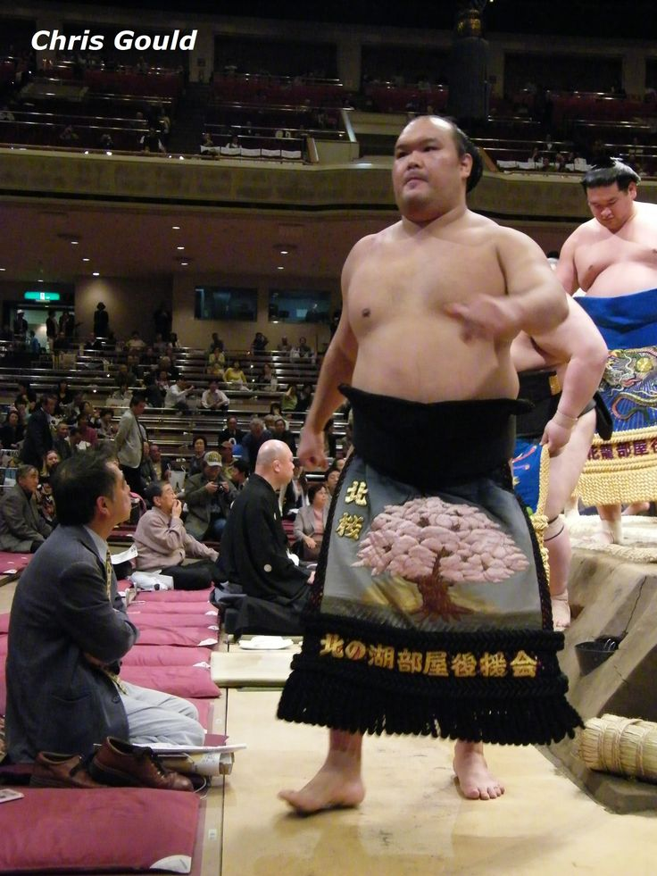 """Kitazakura, whose ring name means """"Cherry Blossom,"""" shows off his resplendent $10,000 ceremonial belt emblazoned with an appropriate theme!"""