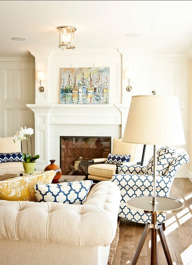 The Living Room Is Painted In A Yellow With Blue Chairs Linen Chesterfield Sofa