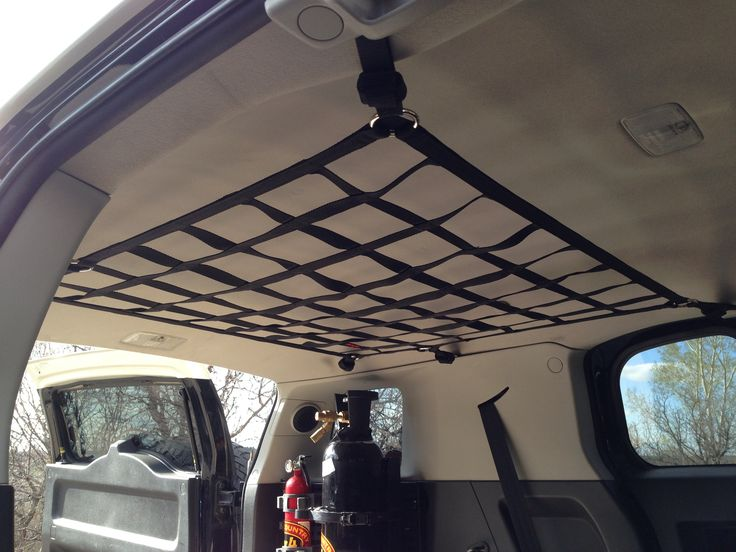 FJ Cruiser ceiling and front seat barrier net  #TOYOTAGEAR  #RAINGLERNETS http://www.raingler.com/#!product/prd1/3885735691/fj-cruiser-ceiling-front-barrier-net
