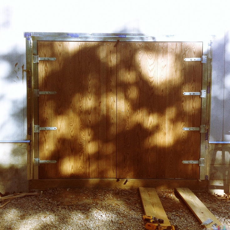 My brother, sons, and I just finished our garage doors. Here are the specs:    Each door is 5 x 8 feet. They are made of 4 inch steel insulated panels, covered with 3/4 inch solid ash. Galvanized hardware, R30 insulation, Sherwin Williams Chestnut Woodscapes stain.