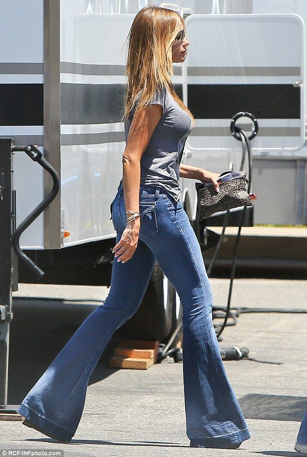 That Seventies show: Sofia Vergara stepped out in a pair of heavily flared denim jeans as she visited a movie set in Los Angeles on Monday