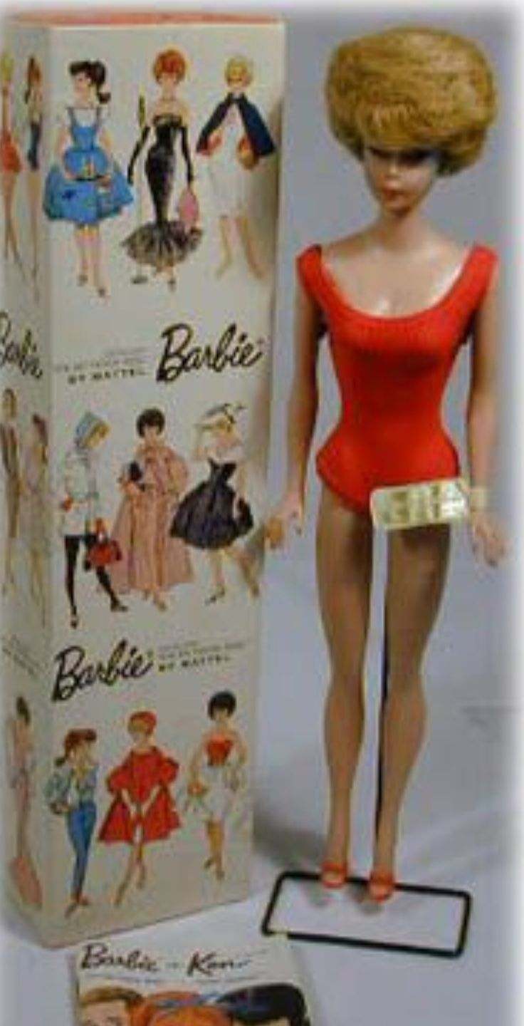 "One of the first Barbies. Mine was like this but her hair was a ""blonde bubble"" instead of redhead."
