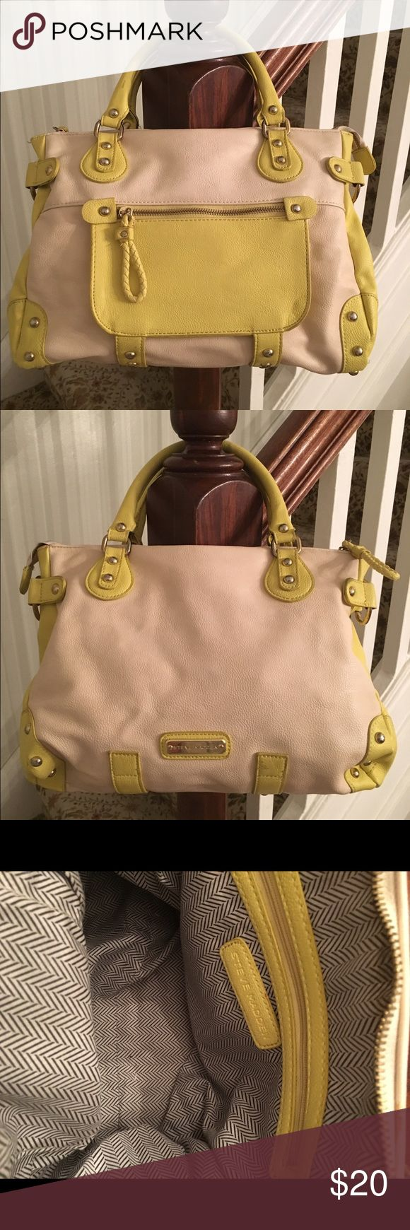 Steve Madden Neon Yellow/Beige Purse Steve Madden neon yellow/beige purse. Has smaller straps and one large strap to wear as broad body bag; zipper functions properly; in great condition; please enlarge photos to see details; if you have any questions, please ask before purchasing Steve Madden Bags Shoulder Bags