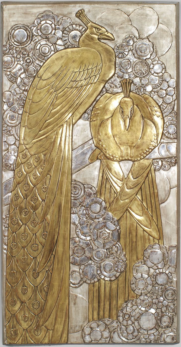 French Art Deco large bias relief wall plaque with a gilt finish showing 2 peacocks (a standing and a perched) with a geometric background.