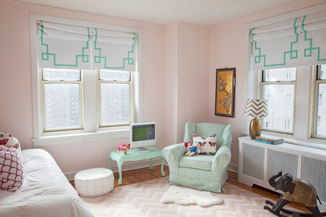 """""""Benjamin Moore's Gentle Butterfly is perfect for any little girl's room,"""" says Wilson. She had these Roman shades custom made, and she repurposed a coffee table to create a pint-size desk for her daughter that's painted in Valspar's Hint of Mint.     Rug: Rugs USA; pouf: Dubai market"""