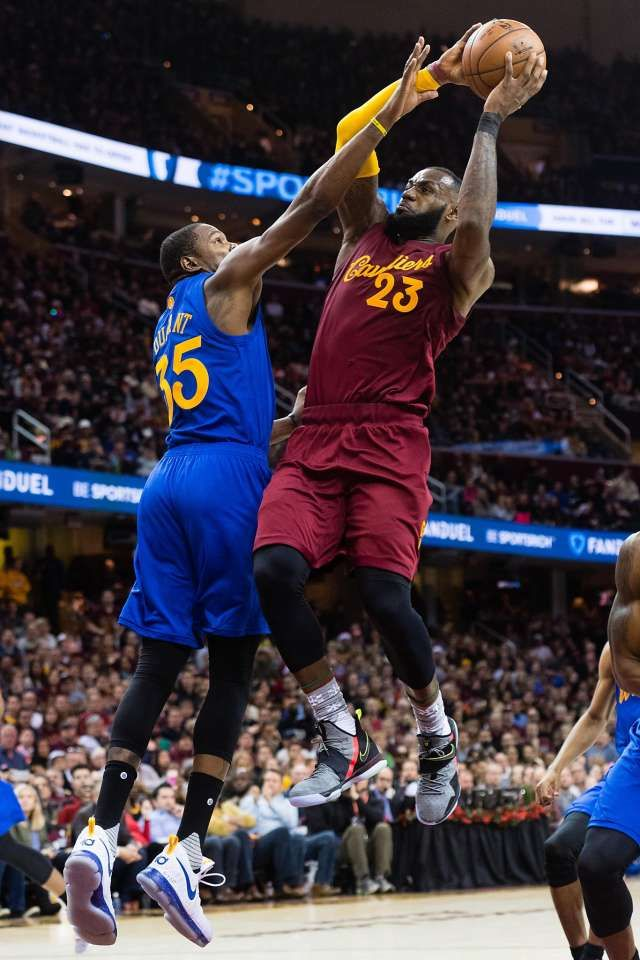 LeBron James #23 of the Cleveland Cavaliers dunks over Kevin Durant #35 of the Golden State Warriors during the second half at Quicken Loans Arena on December 25, 2016 in Cleveland, Ohio. The Cavaliers defeated the Warriors 109-108.