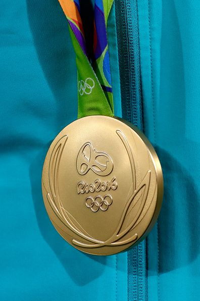 The gold medal Gold of team Australia is displayed after the medal ceremony for…