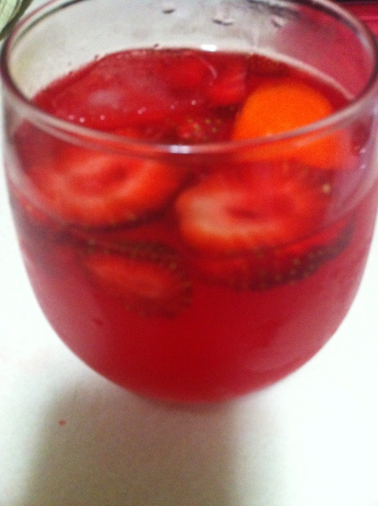 Parrot bay rum mixed with strawberry koolaid and fresh strawberries! Such a delish drink