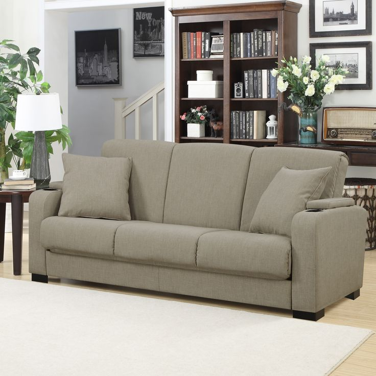 The transitional Portfolio Convert-a-Couch sofa features a convenient storage area and cup holder built into each arm and is covered in a chocolate brown linen-like fabric.