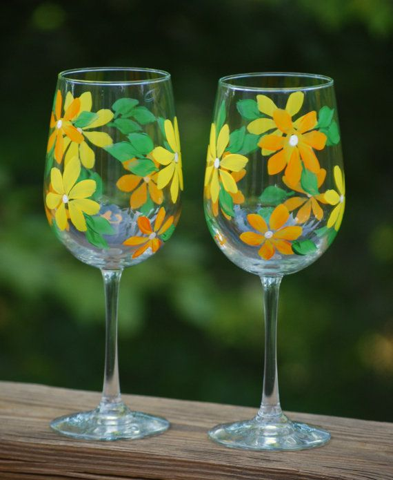 Hand painted wine glasses with pretty orange and yellow wild flowers! This set is for two wine glasses, but a set of four is available upon request. These glasses would be great for any occasion and will dress up a special dinner! If interested in a set of 4 glasses or more, please send me