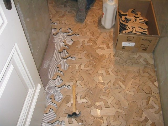 """M. C. Escher Reptiles wooden floor - Spanish flooring company Arbore Historic Floors created this fantastic wooden floor inspired by the famous lithograph """"Reptiles"""" by M. C. Escher. The custom floor was created at the request of a client in Madrid back in 2011."""