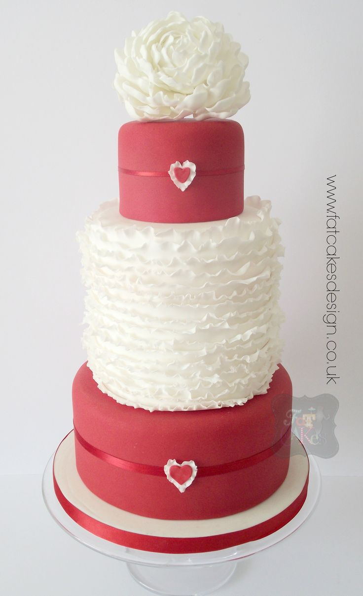 Red and white wedding cake. Ruffles middle tier to match the frilly peony on top. Simple yet striking.