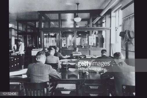 GROUP OF MALE CLERKS WORKING, CIRCA 1920S