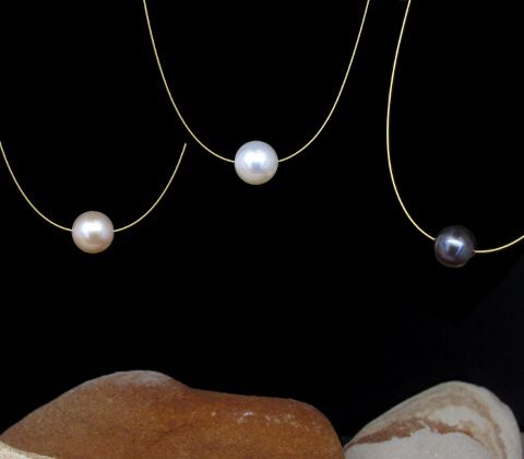l l Single Pearl Necklace l l Gold plated sterling silver clasp and gold wire with colour treated black, pink or white cultured freshwater pearl. Pearl measures approx 9mm. Available in various lengths and gold, silver and monfilament wire.