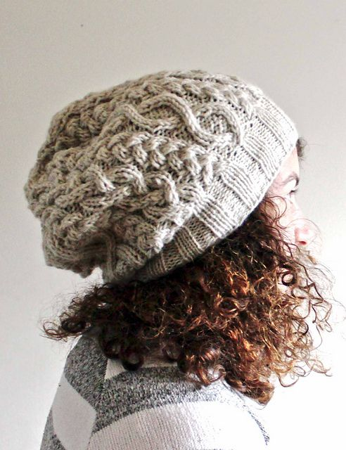 Ravelry: White cabled slouch hat pattern by Nadia Elgawarsha