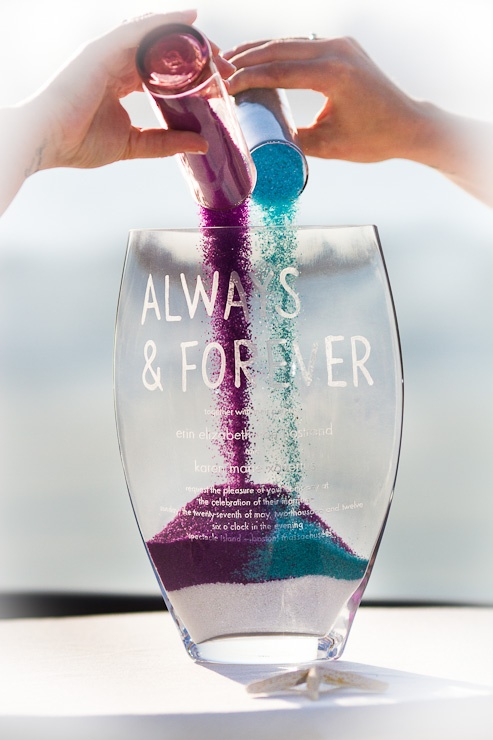 Sand ceremony in engraved vase. Photo by Fucci's Photos.